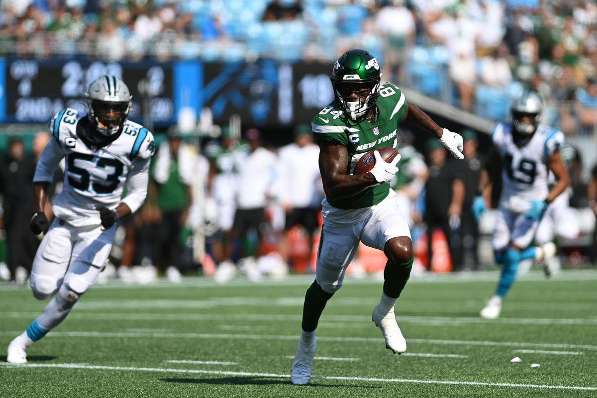 New York Jets wide receiver Corey Davis (84) with the ball as Carolina Panthers defensive end Brian Burns (53) defends in the fourth quarter at Bank of America Stadium.