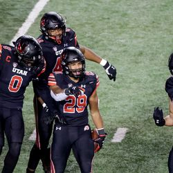 Utah Utes linebacker Nephi Sewell (29) celebrates with teammates after he intercepted a pass during the game against the USC Trojans at Rice-Eccles Stadium in Salt Lake City on Saturday, Nov. 21, 2020.