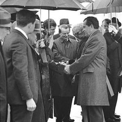 In this Feb. 23, 1969 file photo, then President Richard Nixon shakes hands with Sen. Edward Kennedy, D-Mass., left, before leaving Andrews Air Force Base for Europe. First lady Pat Nixon, head turned, chats with Sen. Robert Byrd, D.W.Va., at center.