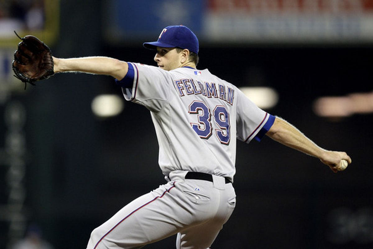 HOUSTON - JUNE 18:  Pitcher Scott Feldman #39 of the Texas Rangers throws home during the first inning against the Houston Astros at Minute Maid Park on June 18, 2010 in Houston, Texas.  (Photo by Bob Levey/Getty Images)