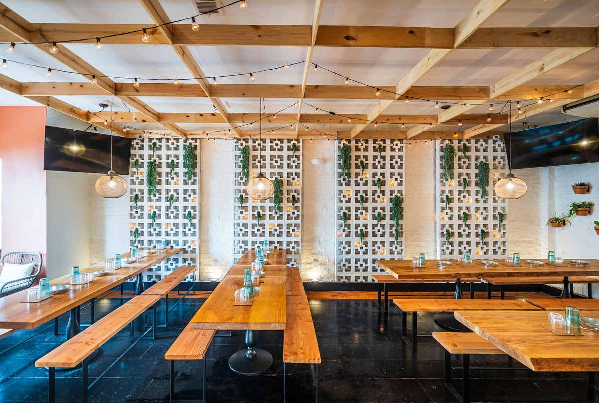 The renovation at Lulu's winegarden included communal tables repurposed from the Vinoteca bar and breezeway blocks that line the walls.