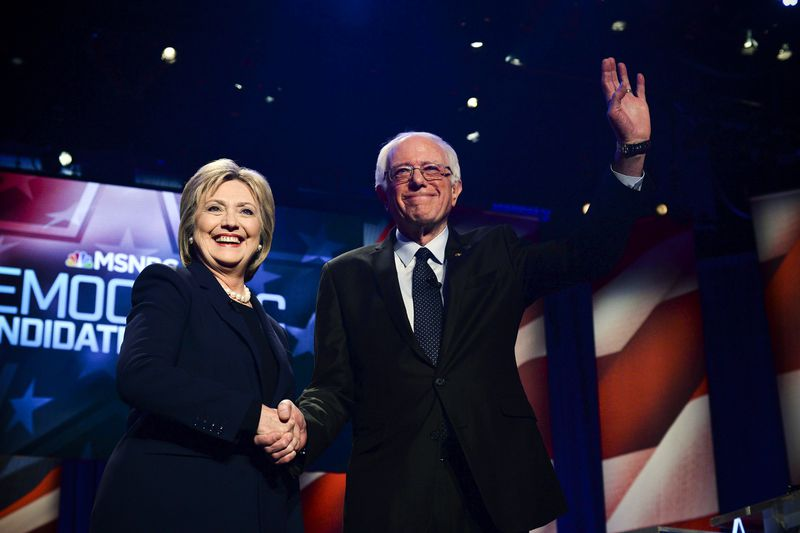 Democratic presidential candidates Hillary Clinton and Bernie Sanders shake hands before participating in the MSNBC Democratic Candidates Debate at the University of New Hampshire, on February 4, 2016. Sanders would go on to win the state's primary.