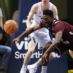 Texas Southern Tigers forward Marquis Salmon (15) loses the ball as he is defending by Brigham Young Cougars guard TJ Haws (30) as BYU and Texas Southern play an NCAA basketball game in Provo at the Marriott Center on Saturday, Dec. 23, 2017.