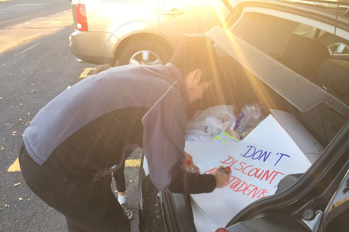 Leslie Aranjo a Jeffco parent and teacher prepares a protest sign Friday morning. A small group of teachers and parents met at the corner of Kipling Street and Bowles Avenue to raise awareness of their concerns about the school district's board majority.