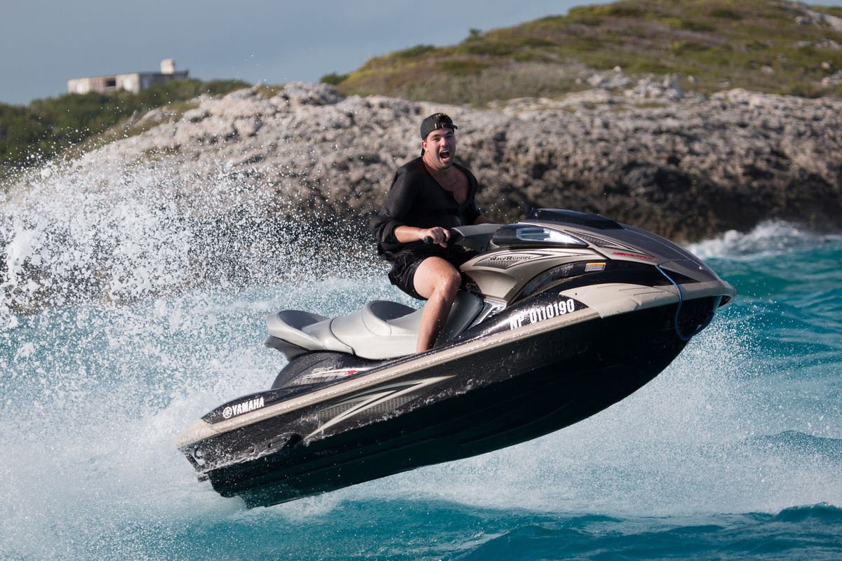 Billy McFarland riding a Jet Ski in Fyre: The Greatest Party That Never Happened
