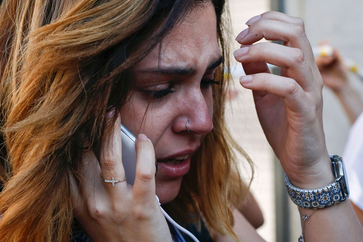 A woman cries as she phones after a van plowed into the crowd, killing one person and injuring several others on the Rambla in Barcelona on August 17, 2017. Police were clearing the area after the incident, which has left a number of people injured.