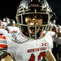 Mountain Ridge's Brody Laga cheers after winning against Wasatch High on Friday, Aug. 27, 2021, at Wasatch High School in Heber City. Mountain Ridge won 40-30.