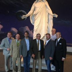 """Gentry Beach, a Trump fundraiser; Stan Parrish, president and CEO of the Sandy Utah Area Chamber of Commerce; Donald Trump Jr.; Ret. Gen. Robert C. Oaks; Mark Geist, author of """"13 Hours""""; Trump for President Utah founder Don Peay; and former Mormon Tabernacle Choir president Mac Christensen pose by the Christus statue on Temple Square in Salt Lake City in September 2016."""