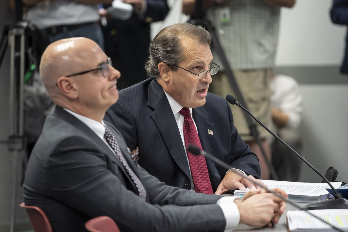 Churchill Downs Senior Vice President Brad Blackwell, left, and Arlington Park President Tony Petrillo answer questions from the Illinois Racing Board in September 2019.