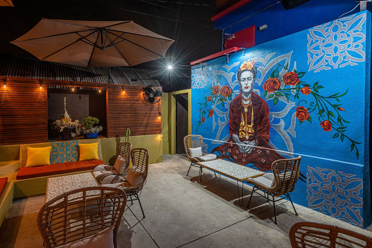 A light blue exterior mural for a new restaurant dining area, at night.