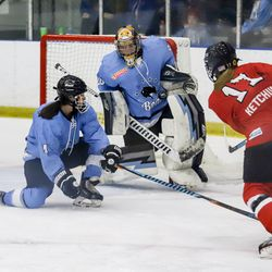 Buffalo Beauts goaltender Amanda Leveille gets position to make the save on Bray Ketchum of the Metropolitan Riveters during a NWHL game on Nov. 4th, 2017 at HarborCenter in Buffalo, NY