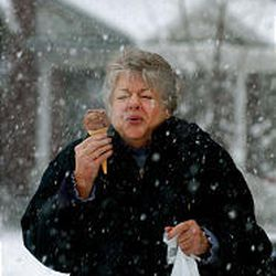 Linda Nicholes of Sugar House shivers as she eats ice cream in the snow.