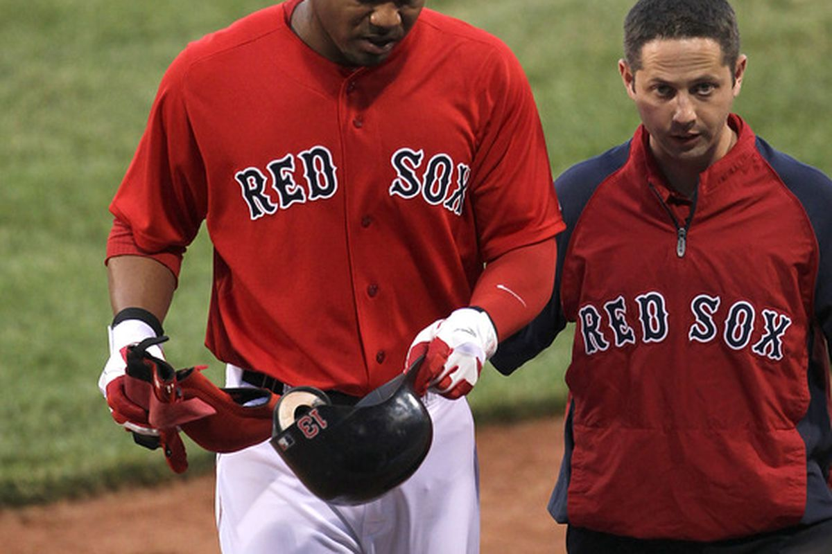 BOSTON, MA  - JUNE 17:  Carl Crawford #13 of the Boston Red Sox leaves the game in the first inning after an injury against the Milwaukee Brewers at Fenway Park on June 17, 2011 in Boston, Massachusetts.  (Photo by Jim Rogash/Getty Images)