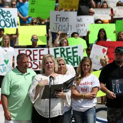 Jason and Laurie Holt, with their children Katie, Jenna and Derek, call for their son Josh's release from a Venezuelan jail at a rally at the Capitol in Salt Lake City on Saturday, July 30, 2016.