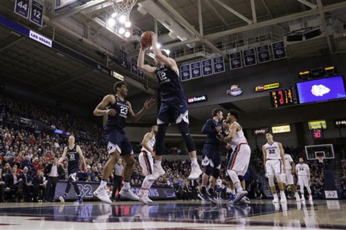 BYU forward Eric Mika (12) grabs a rebound during the second half of an NCAA college basketball game against Gonzaga in Spokane, Wash., Saturday, Feb. 25, 2017.