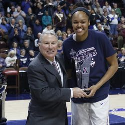 UConn's Azura Stevens (23) poses with AAC commissioner Mike Aresco after being named the Most Outstanding Player of the AAC Tournament