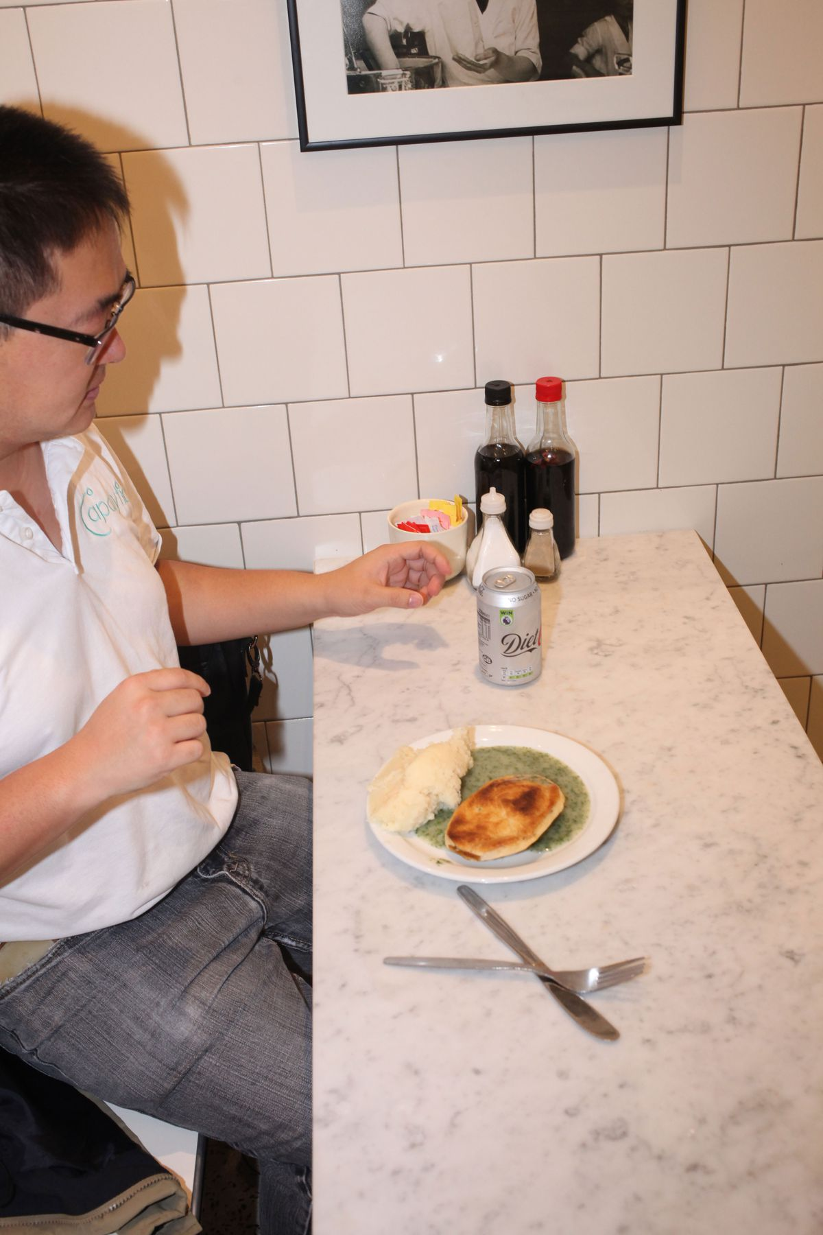 A customer enjoying their pie, mash, and liquor at G. Kelly on the roman road in east London