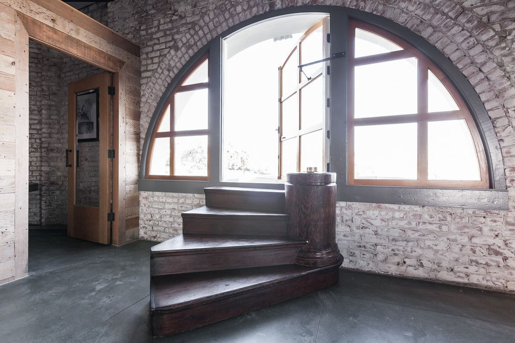A church converted to townhouses uses old relics (like these steps to the pulpit) in new ways. The old steps now lead to a roof deck.