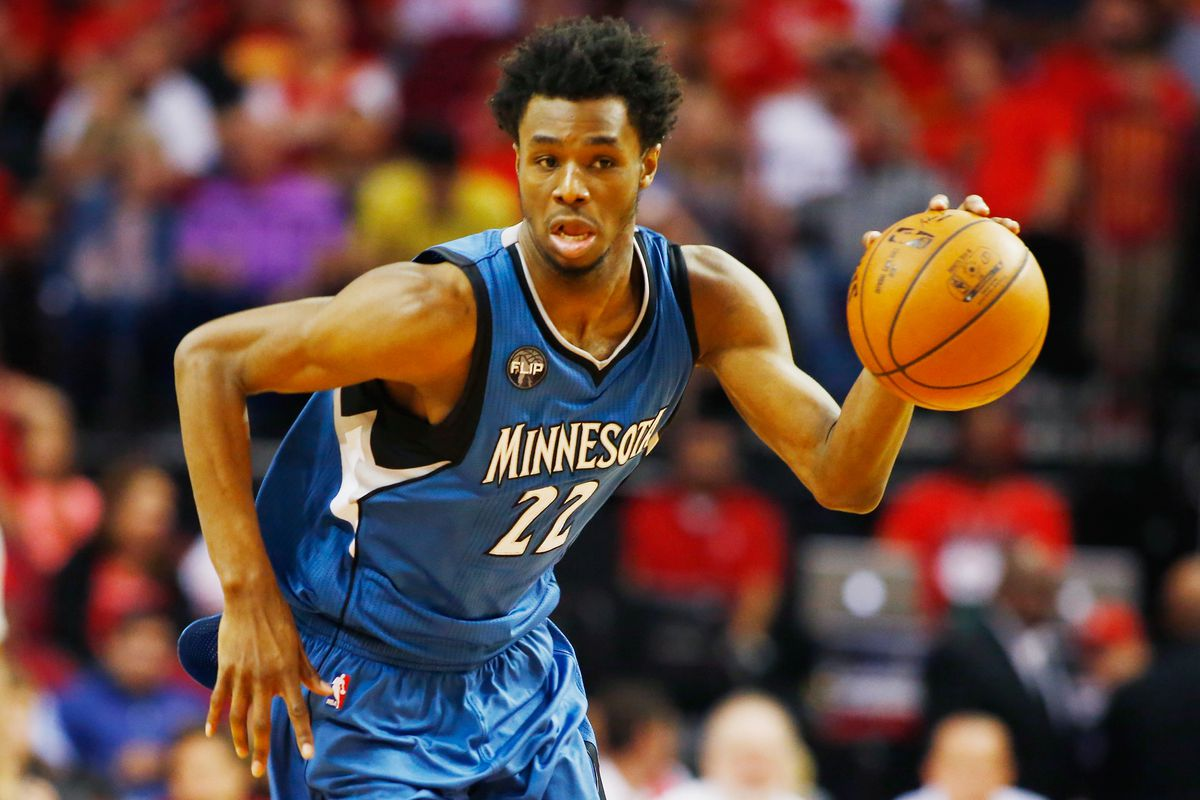 Andrew Wiggins dribbling a basketball