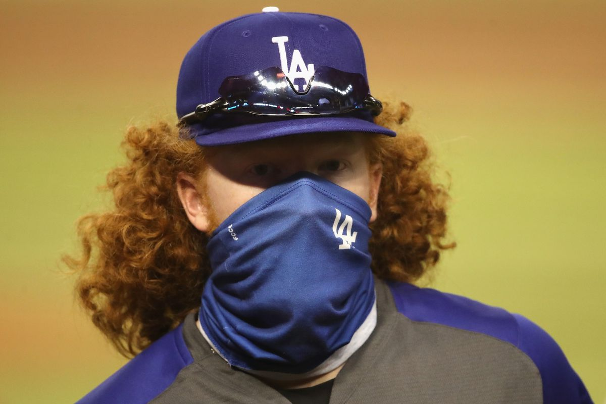 Dustin May #85 of the Los Angeles Dodgers walks off the field following the MLB game against the Arizona Diamondbacks at Chase Field on July 30, 2020 in Phoenix, Arizona. The Dodgers defeated the Diamondbacks 6-3.