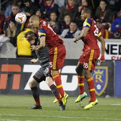 Real Salt Lake forward Alvaro Saborio (15) heads the ball over Toronto FC defender Steven Caldwell (13) as Real Salt Lake defender Chris Schuler (28) backs him up during a game at Rio Tinto Stadium in Sandy on Saturday, March 29, 2014.