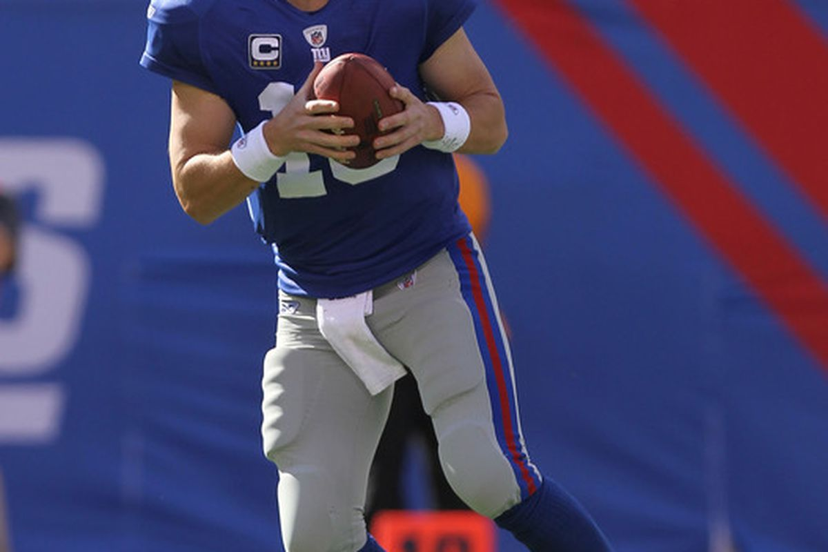Eli Manning (10) of the New York Giants against the Detroit Lions at New Meadowlands Stadium on October 17 2010 in East Rutherford New Jersey.  (Photo by Nick Laham/Getty Images) *** Local Caption *** Eli Manning
