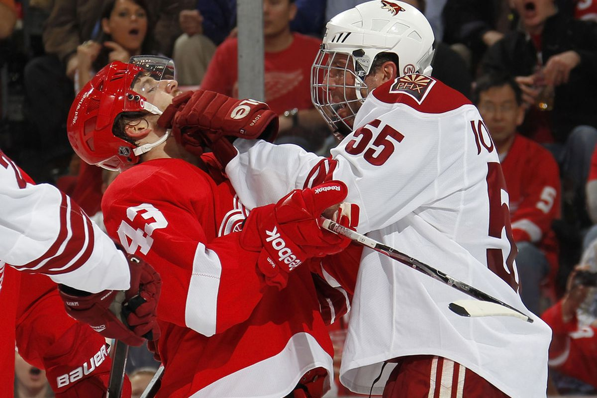 Normally, Jovanovski, I'd agree that the visored Darren Helm should have his face smushed, but your full facemask makes me sick.  This league's going to hell.
