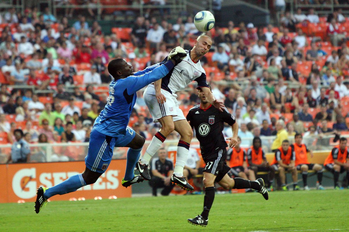 WASHINGTON, DC - JULY 20: Bill Hamid #28 of D.C. United defends the ball against Rajko Lekic #10 of the New England Revolution at RFK Stadium on July 20, 2011 in Washington, DC. (Photo by Ned Dishman/Getty Images)
