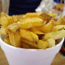 """Five Guys Fries: Made from freshly cut potatoes, fried in peanut oil, served in a Styrofoam cup. Every FIve Guys location features a sign saying where their potatoes came from that day.<br /><br />Found at: Five Guys<br />Photo via <a href=""""http://www.fli"""