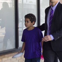 Nine-year-old Diogo, Lidia Souza's son, walks out of the office of Heartland Alliance in Chicago.| Pat Nabong/For the Sun-Times