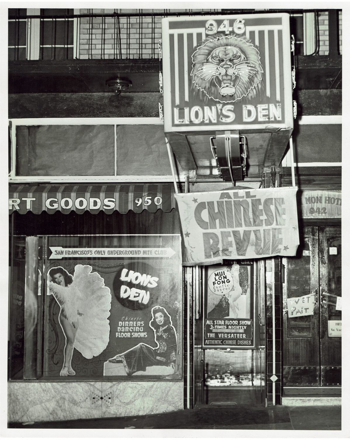 """Black and white photo of the exterior of Lion's Den during the 1940s, with a banner advertising the """"All Chinese Revue."""""""