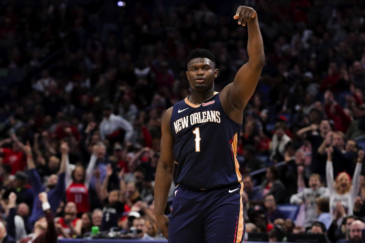 New Orleans Pelicans forward Zion Williamson reacts after a score by guard Jrue Holiday during the third quarter against the Denver Nuggets at the Smoothie King Center.