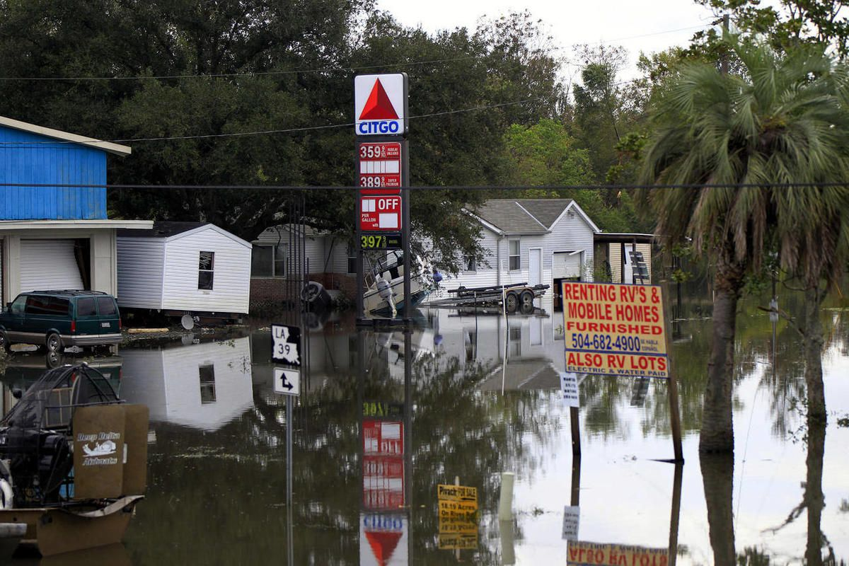 Floodwaters from Hurricane Isaac inundate structures in Scaresdale , La., Sunday, Sept. 2, 2012. More than 200,000 people across Louisiana still didn't have any power five days after Hurricane Isaac ravaged the state. Thousands of evacuees remained at she