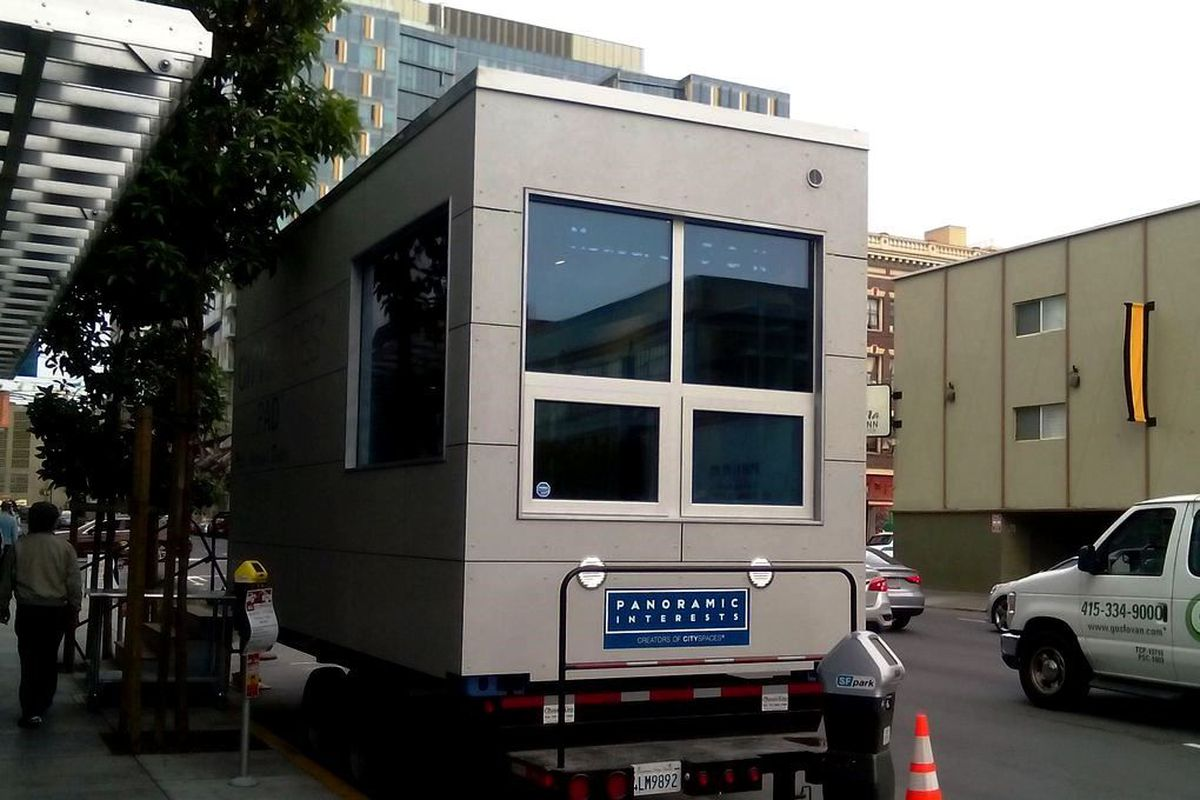 A modular MicroPAD apartment on the back of a truck.