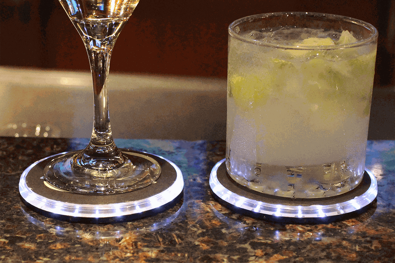 this connected coaster is a silly solution to keep your drink safe at bars