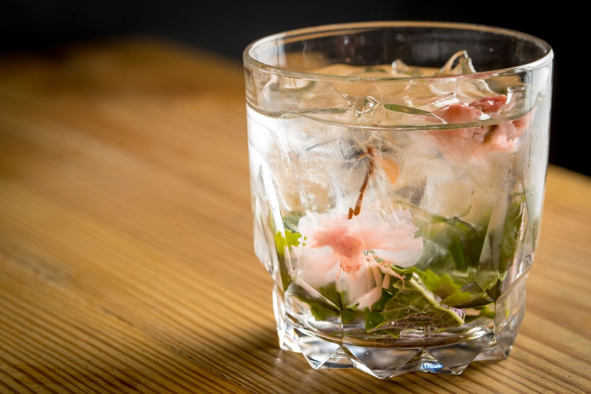 Peach sochu with candied cherry blossoms