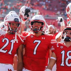 Utah's Solomon Enis (21), Cameron Rising (7) and Britain Covey celebrates their win against Washington State after an NCAA college football game at Rice-Eccles Stadium on Saturday, Sept. 25, 2021 in Salt Lake City. Utah won the game 24-13.