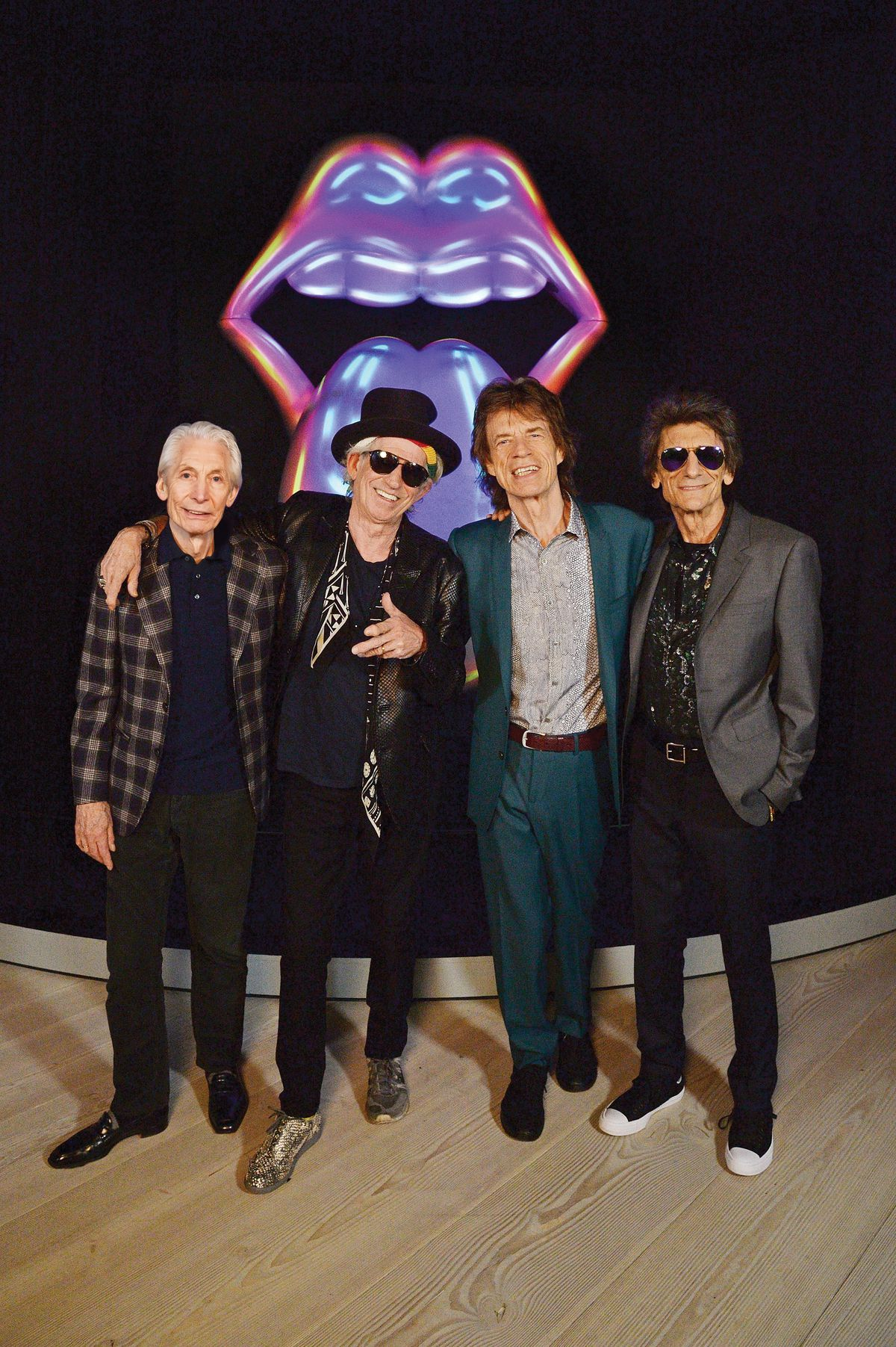 Charlie Watts (from left), Keith Richards, Mick Jagger and Ronnie Wood of The Rolling Stones pose for a photo during a preview of 'The Rolling Stones: Exhibitionism' at Saatchi Gallery on April 4, 2016 in London, England.   Photo by Dave J Hogan