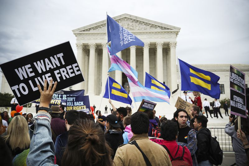 Protesters rally in front of the U.S. Supreme Court.