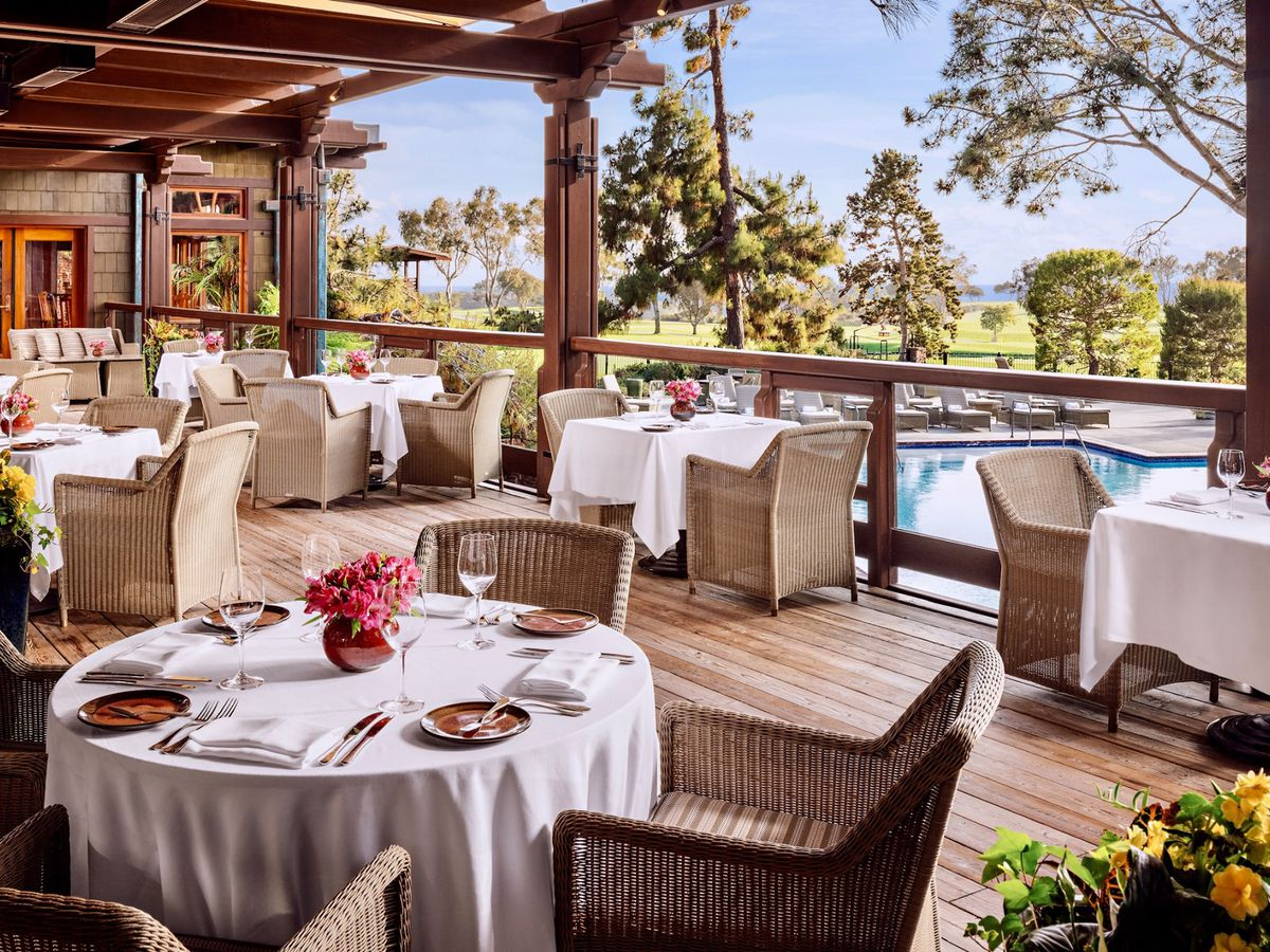 The outdoor dining patio at A.R. Valentien overlooking Torrey Pines Golf Course.