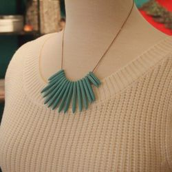For day, Alina adds a pop of color with this turquoise necklace ($118) by Soixante Neuf.