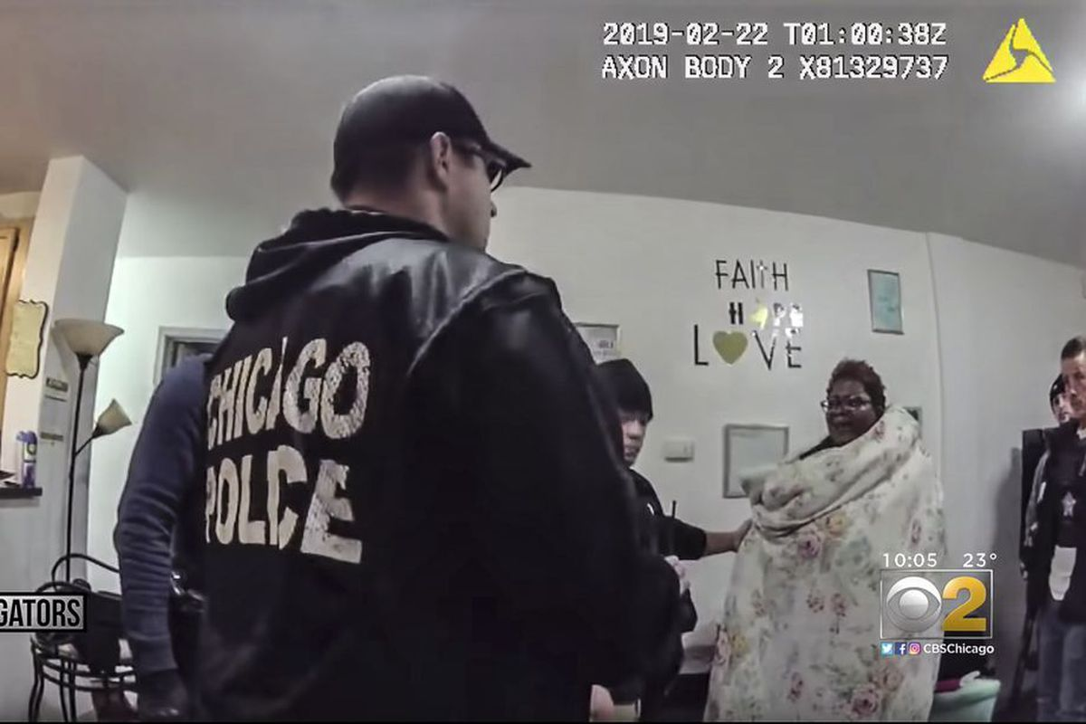 A screenshot from body-camera video of a police raid in 2019 at the home of social worker Anjanette Young. The police were in the wrong home.