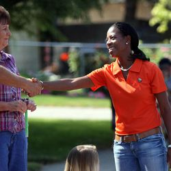 Mia Love greets people while walking in the Harvest Days Parade in Midvale on Saturday, Aug. 11, 2012.