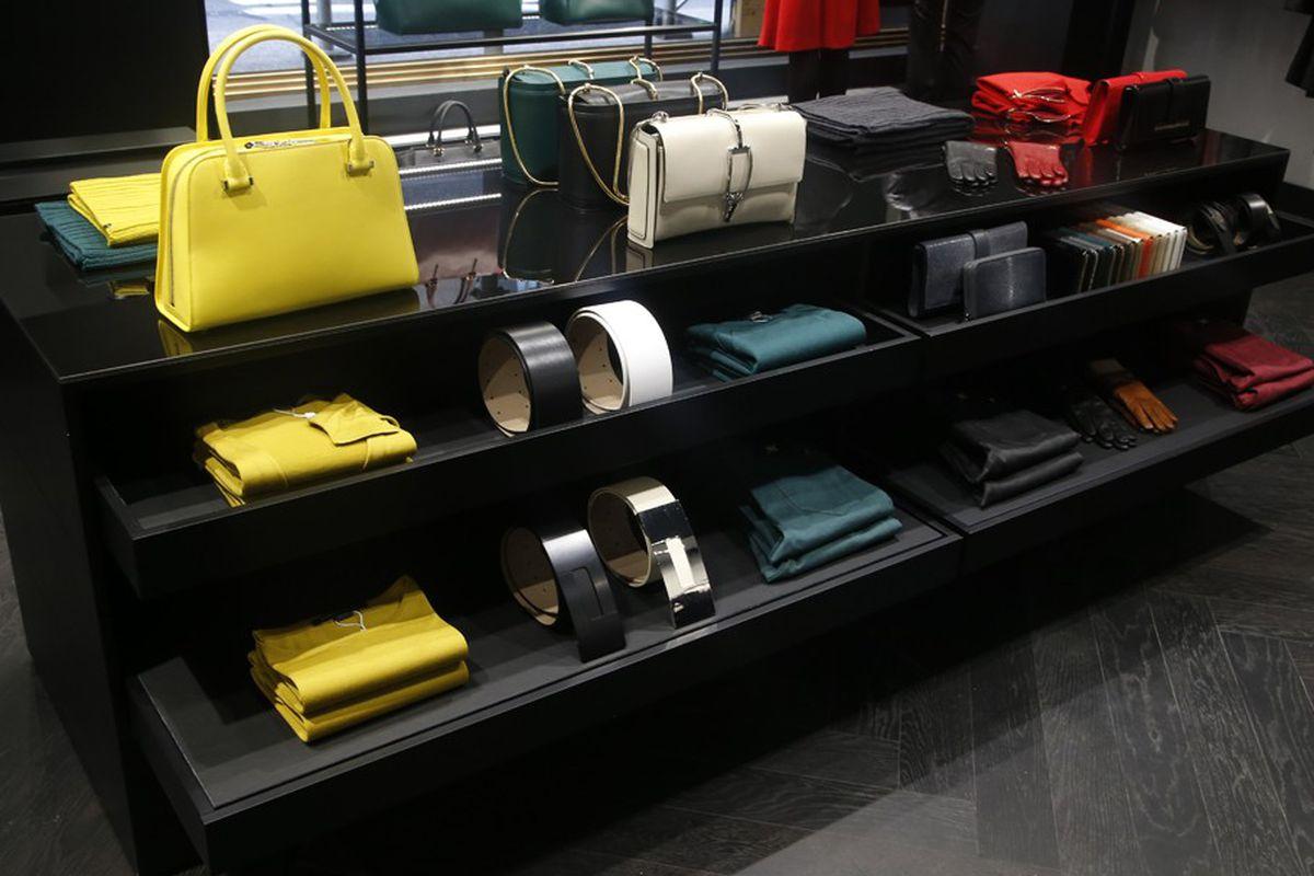 "Photo: <a href=""http://media.wwd.com/retail-news/designer-luxury/porsche-design-opens-on-madison-7961375"">WWD</a>"