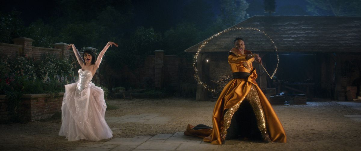 A ball gown Cinderella (Camila Cabello) and her fabulous godmother (Billy Porter) dance outside in Amazon's Cinderella