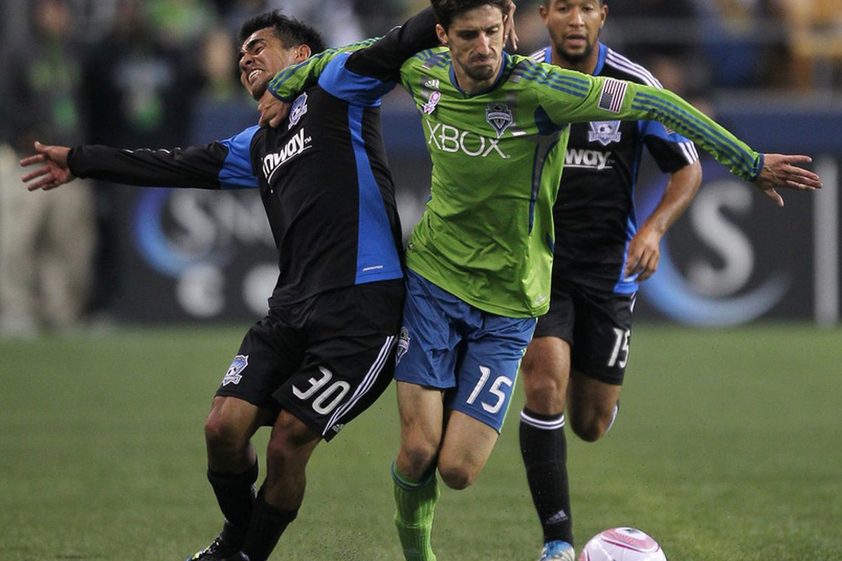 SEATTLE - OCTOBER 15:  Alvaro Fernandez #15 of the Seattle Sounders FC battles Rafael Baca #30 of the San Jose Earthquakes at CenturyLink Field on October 15th, 2011 in Seattle, Washington. (Photo by Otto Greule Jr/Getty Images)