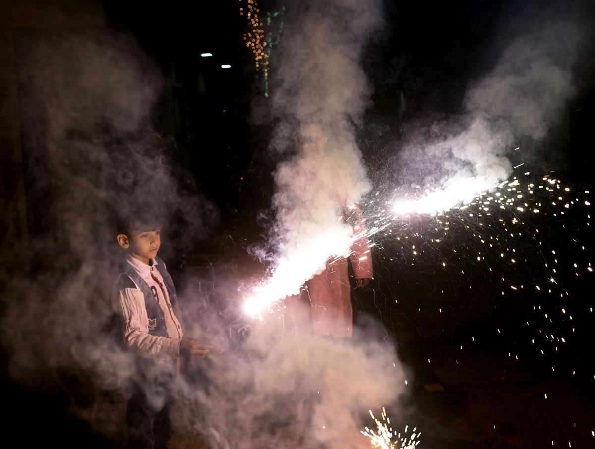 A child holds a firework during Diwali on November 7, 2018 in New Delhi, India. The city is suffering from some of the worst pollution in the world.