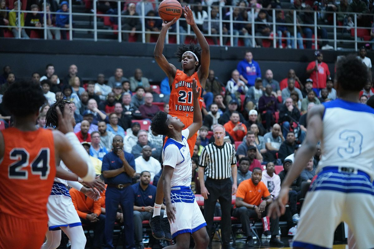 Young's DJ Steward (21) pulls up for a shot against Curie.