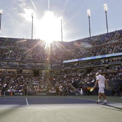 Andy Roddick walks onto the court during his quarterfinals match against Argentina's Juan Martin del Potro at the U.S. Open tennis tournament, Wednesday, Sept. 5, 2012, in New York. (AP Photo/Darron Cummings)
