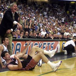 Utah coach Jerry Sloan yells for a foul as John Stockton and the Maverick's Steve Nash hit the floor as the Jazz face the Mavericks at Reunion Arena Saturday, April 28, 2001.